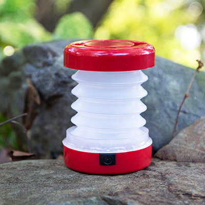 EASYLIVING™ Mini Collapsible Camping Lantern - Easy to pack and store, this collapsible camping lantern features 5 bright LEDs.  Push button feature changes lantern from bright to blinking.  Measures 3½